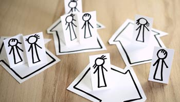 Paper dolls symbolizing isolation