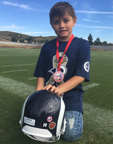 TAPS boy with LA Rams helmet