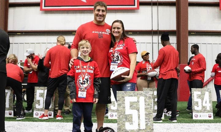 TAPS mom and son with Falcons Football player Alex Mack