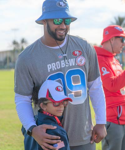 TAPS girl with NFL Player at 2019 NFL Pro Bowl