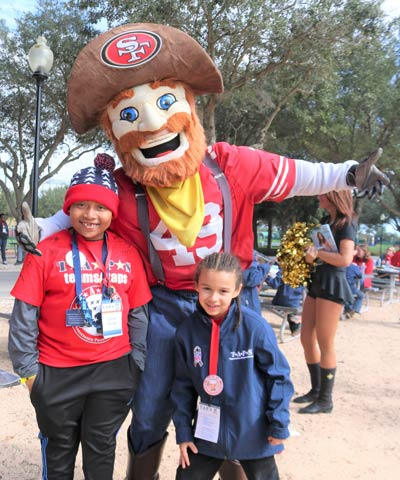 TAPS children with mascot at 2019 NFL Pro Bowl