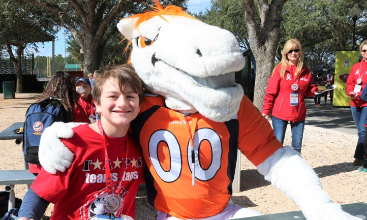 TAPS boy with mascot at 2019 NFL Pro Bowl