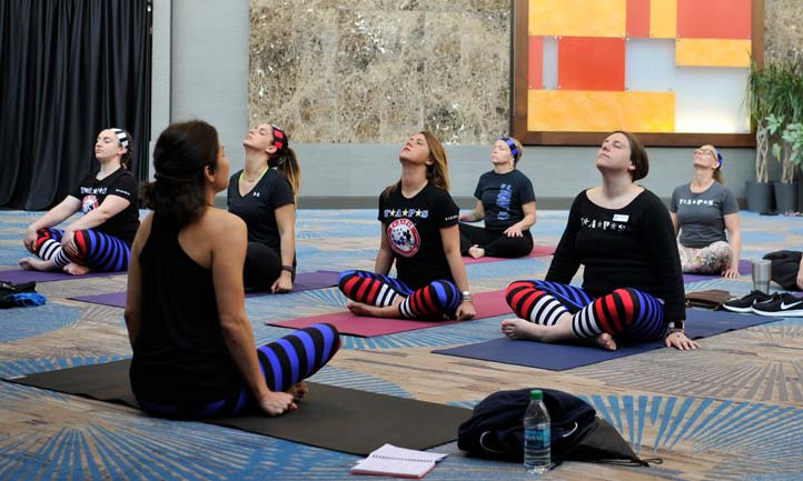 Military surviving women in yoga session