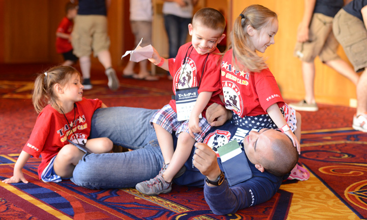 Good Grief Camp Mentor Playing with Kids at 2016 National Seminar