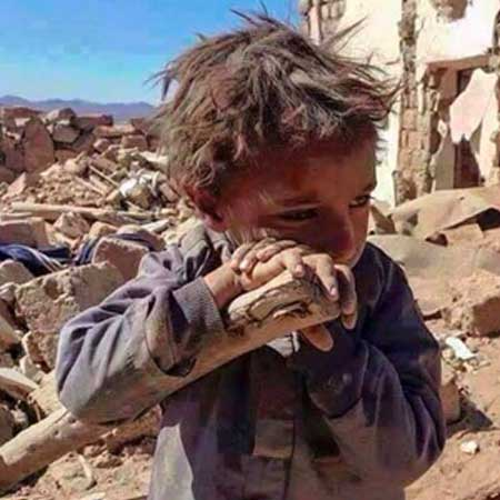 Little Afghan boy crying in war zone