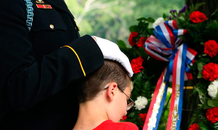 TAPS Magazine spring 2008 cover, military member comforts grieving child