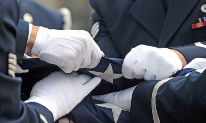 TAPS Magazine spring 2011 cover, folding flag at Arlington National cemetery