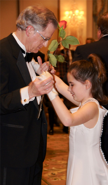 Amy's daughter dancing with grandfather