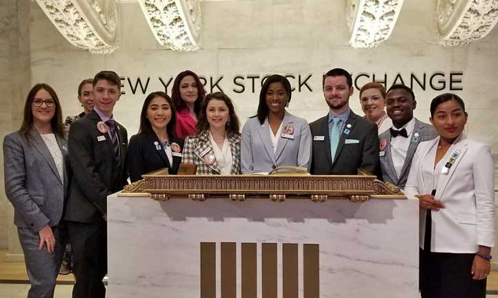 Jaisha Haynes, center, and a group of young adult survivors toured the trading floor at the New York Stock Exchange