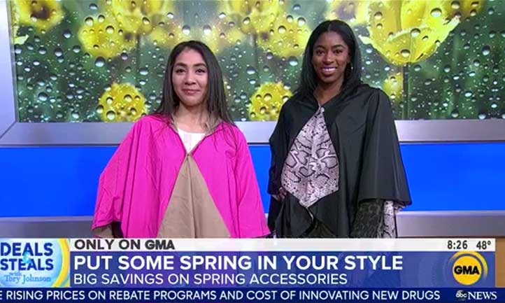 Nichole Baldwin, left, and Jaisha Haynes, right, modeled spring ponchos on a live segment of Good Morning America.