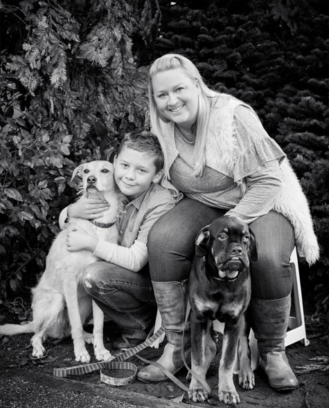 Crystal and her son Max and their foster dogs