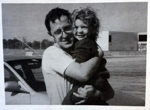 Carolyn Horton as a little girl being held by her father