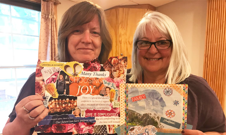 Survivors Stephanie Keegan, left, and Marilyn Weisenburg show the vision boards they created at the Sedona Women's Retreat last year.