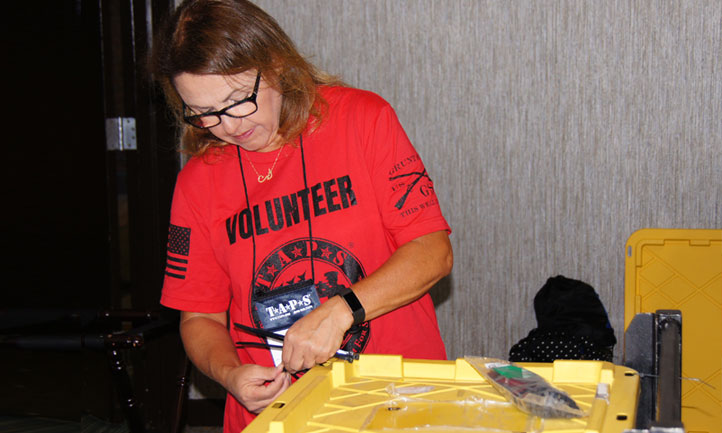 volunteer in Denver packs supplies at the Colorado Regional Seminar and Good Grief Camp