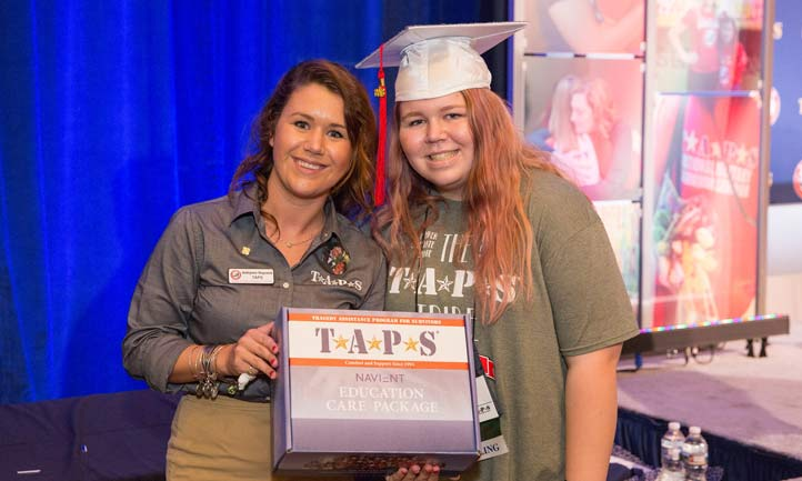 Surviving military teen receives a college care package during TAPS Graduation at the National Military Survivor Seminar in Washington, D.C.