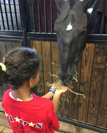 Arianna Bryant visited the stables at Fort Myer