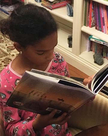 "Arianna Bryant reading ""Klinger: A Story of Honor and Hope"" is one of her favorite books."