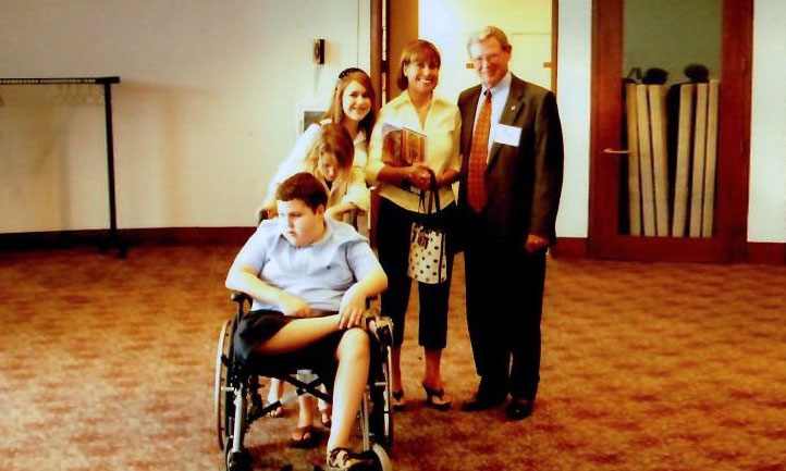 Oklahoma Sen. Jim Inhofe, right, is shown on Capitol Hill in 2006 with Nichole Haycock, second from right, and her children
