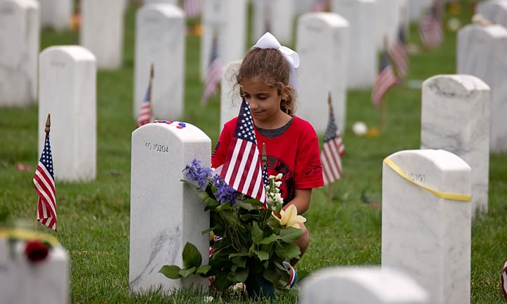 Young Survivor at headstone in Arlington National cemetery