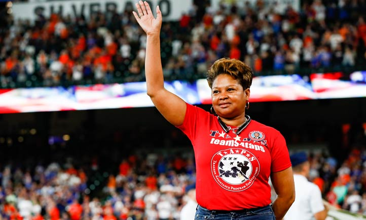 Kendra Wilson-Hudson wave to crowd at Houston Astros game