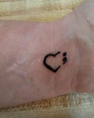 Lydia's broken heart tattoo