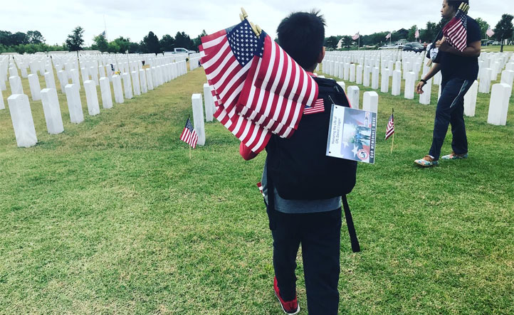 laying flags at cemetery