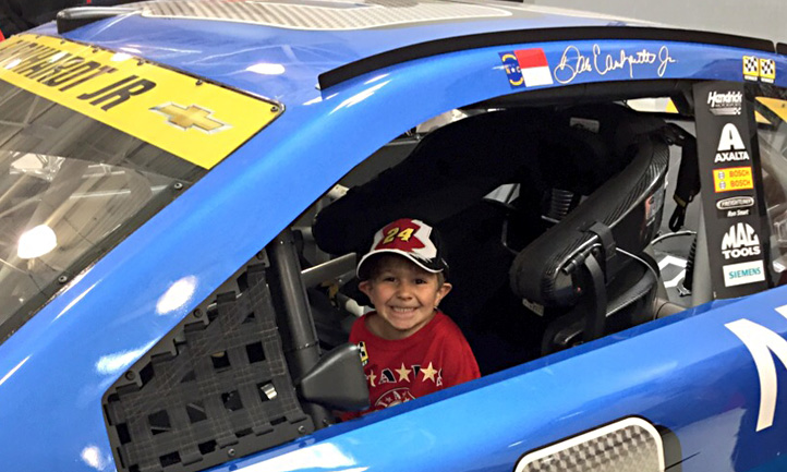 Boy in Nascar car